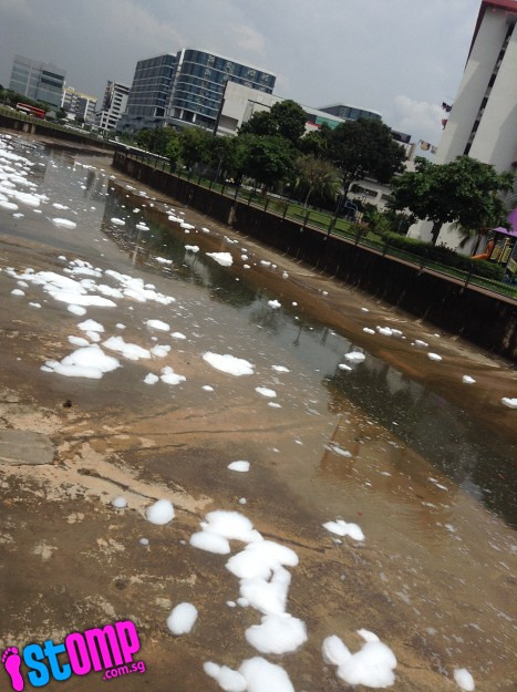 Sudsy deposits turn water in Sungei Kallang drain white
