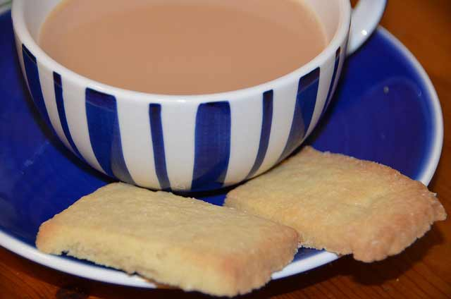 Shortbread bicuits in a cup and sacuer