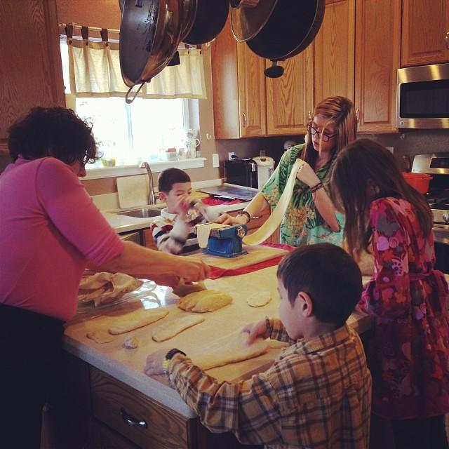 Making lasagna noodles is a team effort.