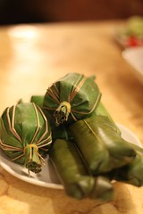 Mystery meat wrapped in Banana Leaves
