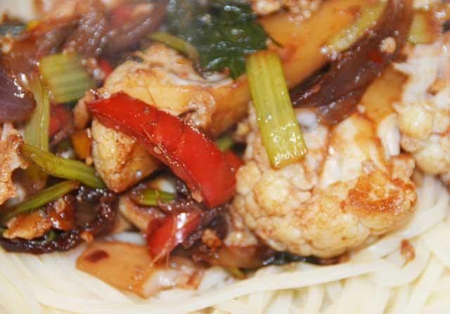 vegetable stir fy on a bed of noodles
