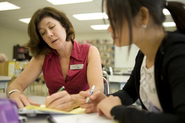 Header of alumna