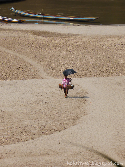 Luang Prabang Ock Pop Tock 03 VIew of Mekong Lady with Umbrella