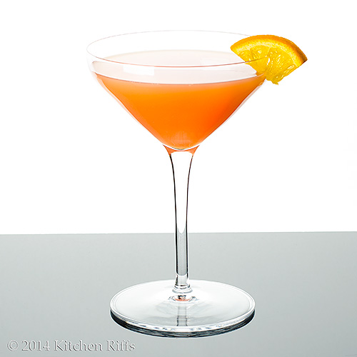 Monkey Gland Cocktail in cocktail glass with orange slice garnish