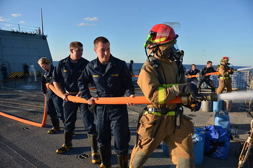 Midshipmen from the U.S. Naval Academy and other universities take part in firefighting training