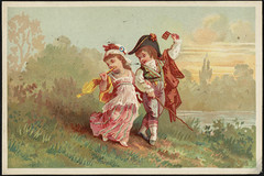 Boy and girl in historical costume, walking together.
