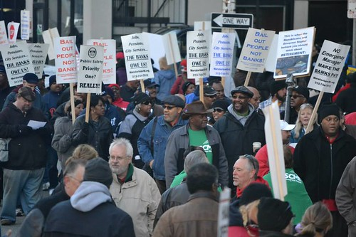 People took the streets in front of the federal courthouse in downtown Detroit during the first day of a bankruptcy trial.