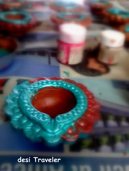Painting Diyas for a Green Diwali