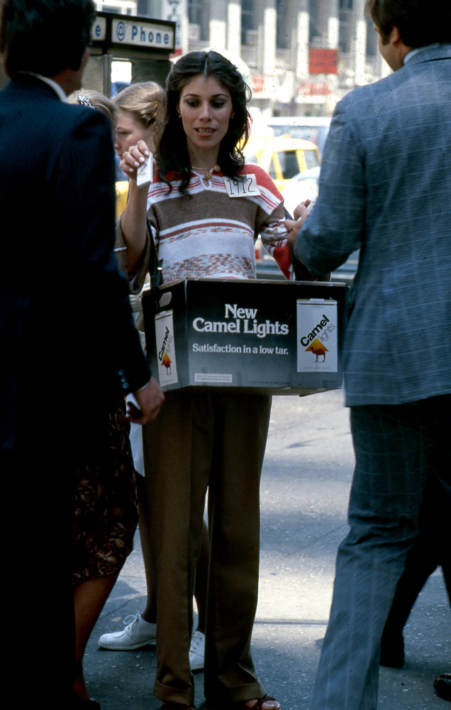"GIRL PROMOTING ""NEW CAMEL LIGHT"""