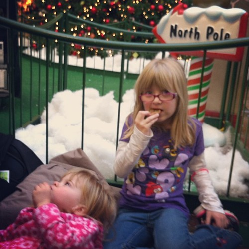 Camped out in line eating cookies while we wait for this mall Santa to get back from his break.