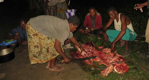 fisher family helps divide up the pork