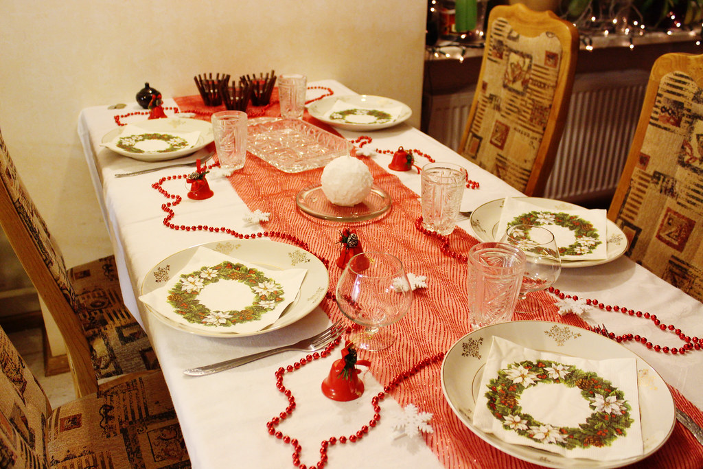 Christmas dinner table with red decorations