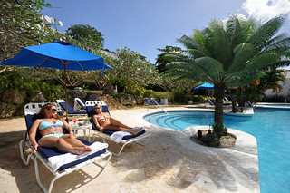 Sunbathing by the pool - Couple relaxing in pool - Royal Westmoreland estate, Barbados