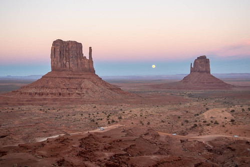 Monument Valley sunset and moon rise between the West and East mittens