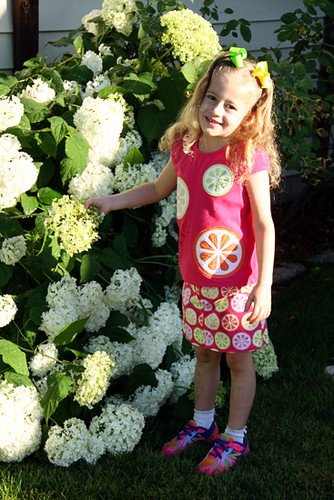 Aut-standing-next-to-hydrangea-bush