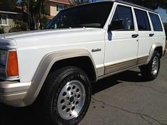 jeep liberty(0.0), automobile(1.0), automotive exterior(1.0), sport utility vehicle(1.0), jeep cherokee (xj)(1.0), wheel(1.0), vehicle(1.0), compact sport utility vehicle(1.0), rim(1.0), bumper(1.0), land vehicle(1.0), luxury vehicle(1.0),