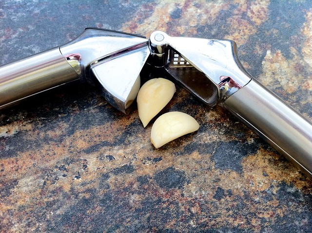 2 Garlic Cloves with Garlic Press