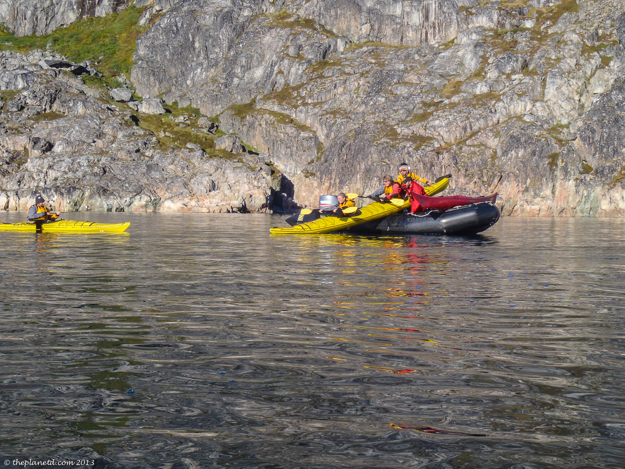 Kayak surfing into the water in Greenland