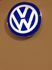 signage(0.0), wheel(0.0), number(0.0), logo(1.0), symbol(1.0), trademark(1.0), font(1.0), emblem(1.0), circle(1.0), blue(1.0),