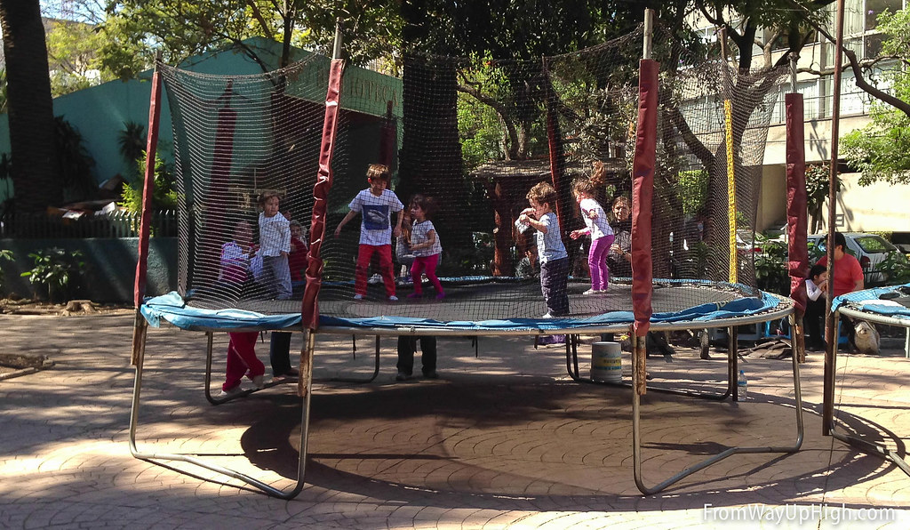 Kids jump on a trampoline in Parque Mexico, Xexico City