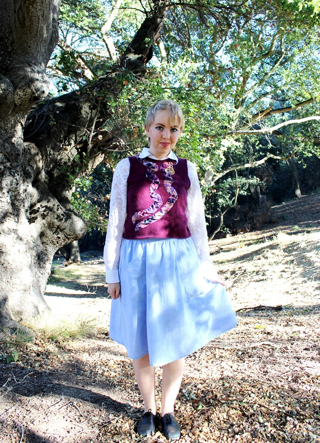 embellished plum cashmere vest, white lace button-down shirt, blue midi skirt