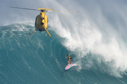 Albee Layer sharing a barrel with a helicopter at Peahi.