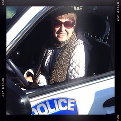 My mom driving a real police car. They gave her the keys.