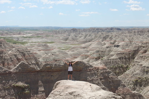 Brie with the badlands behind her