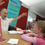 Tony Robinson signing books for young fans |