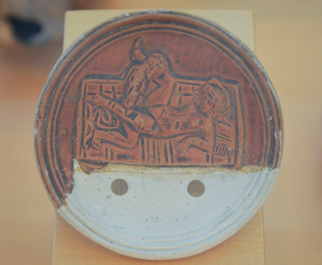 A fragment of the discus of an oil lamp depicting an erotic scene, 1st century AD, Archaeological museum Narona, Vid, Croatia