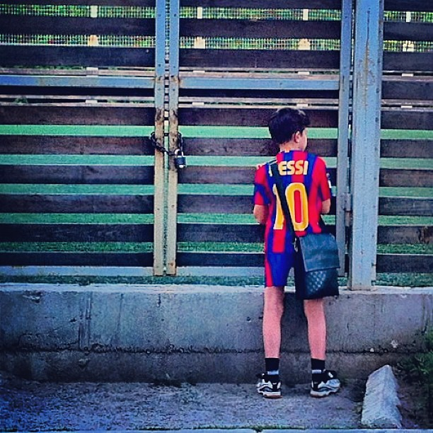 Young Messi. #young #boy #kid #messi #football #player #sport #fence #pitch #field #game #street #life #moment #streetphoto #streetphotography #documentary #documental #social #alone #iphone #city #dnepropetrovsk #ukraine
