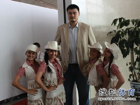 July 11th, 2013 - Yao Ming takes photos before departing on the airline's inaugural flight between Beijing and Houston
