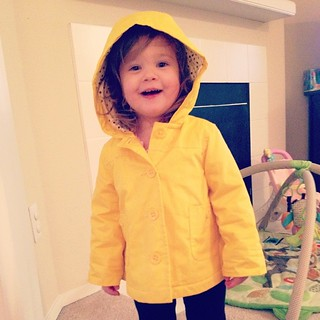 Someone's excited about her new rain coat - a clearance find from @babygap!