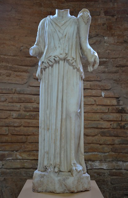 Marble statuette of Fortuna holding a cornucopia and wearing a peplos, from the Roman Baths, 1st-2nd century AD, Archaeological Museum of Sikyon, Greece