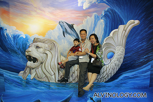 Asher with my parents on the Merlion Boat