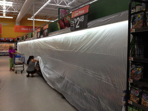 In attempts to save the produce from the 110 degree heat outdoors the Pratt Walmart covers the coolers