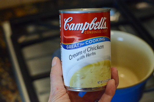 A can of Campbell's Cream of Chicken with Herbs
