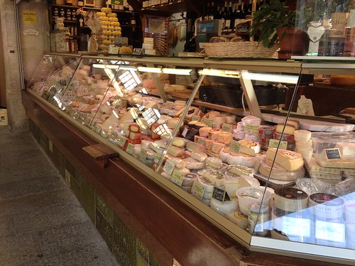 Cheese display at Place d'Aligre market