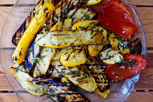 Platter of grilled vegetables on wooden table