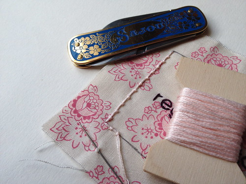 Stitching up a quilt tag