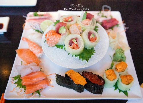 Customized sushi and sashini platter of four different orders