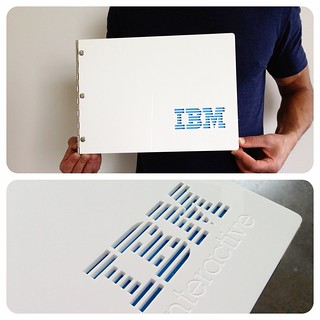 Custom portfolio book in white acrylic with engraving and cut-out treatment for IBM Interactive