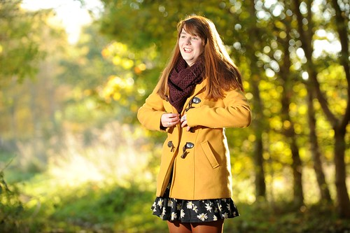 Mustard coat, floral dress, boots