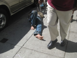Sleeper on sidewalk, Ellis Street between Taylor and Jones, San Francisco