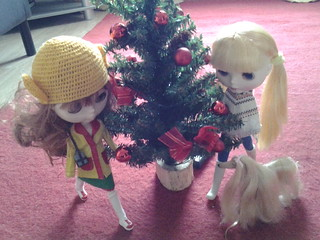 The girls look at the Christmas tree.