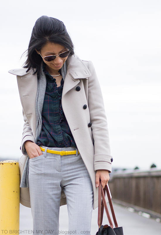 trench coat, open cardigan, plaid shirt, yellow belt, gray trousers