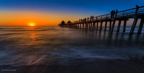 ocean blue sunset sky people orange reflection silhouette pier waves glow gulf unitedstates florida horizon crowd naples boardwalk fl bluehour hanusiak