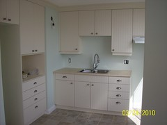 floor, room, property, plumbing fixture, cabinetry, sink,