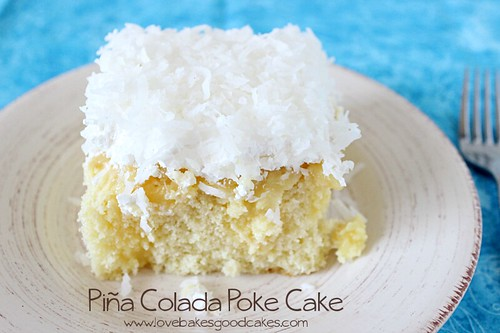 Pina Colada Poke Cake piece on plate with fork.