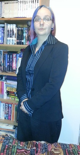 Me in stripy shirt and suit jacket, posing